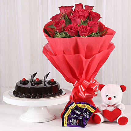 Flower Hamper - Bunch of 12 Red Roses with 5 cadbury , Soft toy and 500gm gifts .